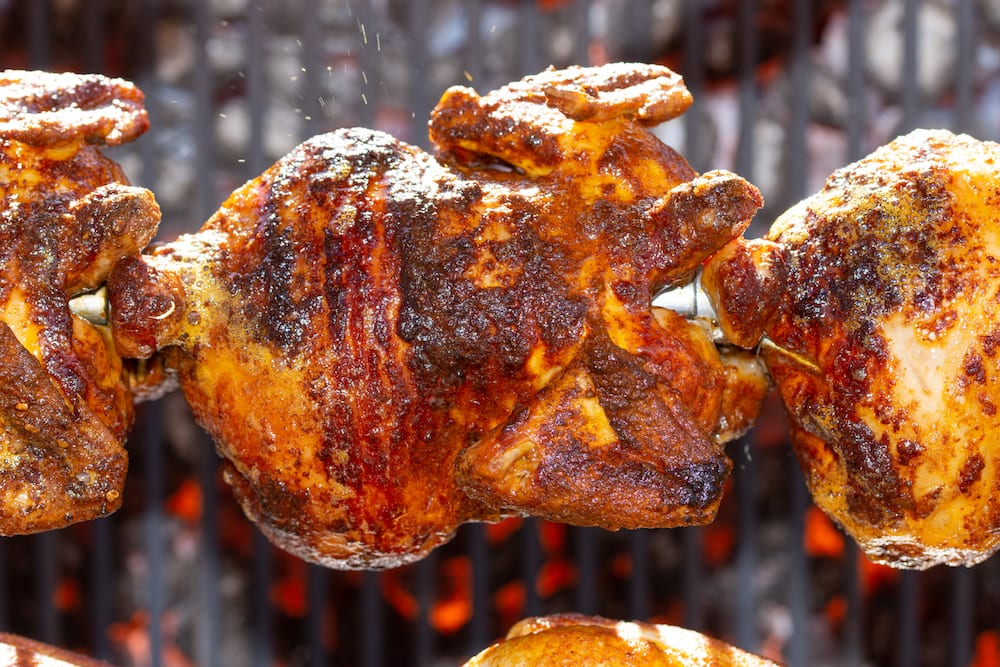 Rotisserie,,roasted,Chickens,On,Spit,Grilled,Over,Fire,Of,A